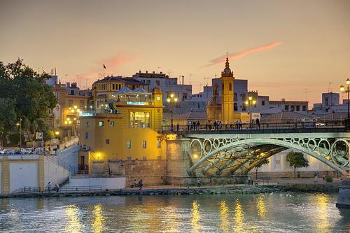 Triana at night bridge seville